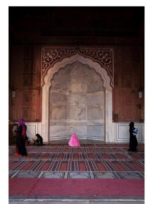 Woman praying at the Mosque
